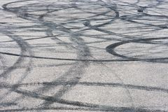 Car track with rubber drift traces. asphalt pavement background texture stock photo