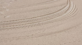 A car track in the sand Stock Images