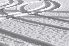Car track in the snow Royalty Free Stock Photos