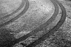Car track on snowy road in black and white. Abstract background and pattern Royalty Free Stock Photography