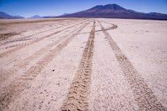 Car tracks on salt lake at Salar de Uyuni, Bolivia royalty free stock photo