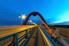 Car traffic on the bridge at night Stock Image