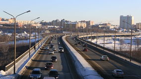 Car traffic on bridge. Winter city Omsk. Timelapse stock footage