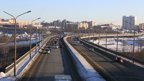 Car traffic on bridge. Winter city Omsk. Timelapse. Car traffic on the bridge. Winter city Omsk. Timelapse stock footage