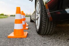 Car and traffic cones, driving school concept