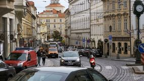 Car Traffic and Czech Tram Rides through the Old City of the Czech Republic, Prague. Slow Motion. CZECH REPUBLIC, PRAGUE, SEPTEMBER 12, 2017: Car Traffic and stock video