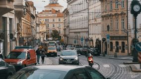 Car Traffic and Czech Tram Rides through the Old City of the Czech Republic, Prague. Slow Motion. CZECH REPUBLIC, PRAGUE, SEPTEMBER 12, 2017: Car Traffic and stock video footage