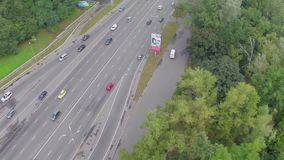 Car traffic driving fast on busy city freeway, aerial view. Stock footage stock footage
