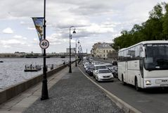Car traffic on the embankmen. SAINT-PETERSBURG, RUSSIA - 12 JUNE, 2015: Car traffic on the embankment of the river Neva in St. Petersburg, Russia, June, 2015 Stock Image