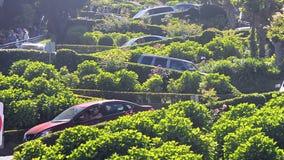 Car traffic on famous Lombard Street, San Francisco, USA,. SAN FRANCISCO, USA - APRIL 30: car traffic on famous Lombard Street on April 30, 2017 in San Francisco stock footage