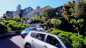 Car traffic on famous Lombard Street in San Francisco, USA,. SAN FRANCISCO, USA - APRIL 30: car traffic on famous Lombard Street on April 30, 2017 in San stock footage