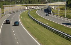 Car traffic on a fast-moving road built with sound absorbing panels. Noise protection. Noise protection. Car traffic on a fast-moving road built with sound royalty free stock photo
