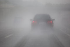Car traffic with fog and rain. Car traffic on a foggy and rainy day on a motorway stock image