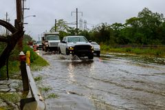 Car traffic in a heavy rain on a flooded road. Flooding roadway after the rain royalty free stock image