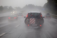 Car traffic at heavy rain Royalty Free Stock Image