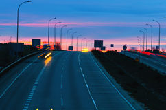 Car traffic on highway in evening Royalty Free Stock Photos