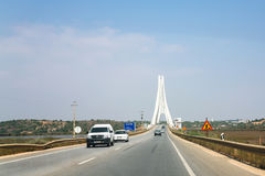 Car traffic on highway near Portimao bridge. PORTIMAO, PORTUGAL - JUNE 18, 2006: car traffic on highway near cable-stayed bridge over Arade river. The bridge was Royalty Free Stock Photos