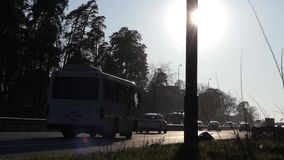 Car Traffic on Highway at Sunset. The Action in Real Time stock video footage