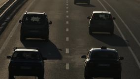 Car Traffic on Highway at Sunset. The Action in Real Time stock footage