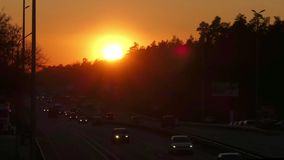 Car Traffic on Highway at Sunset in Time Lapse. Amazing Action. Car Traffic on Highway at Sunset in Time Lapse stock video footage
