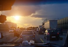 Car traffic jam on the highway during the evening rush hour.Shooting from the car cabin. Toning Royalty Free Stock Photo