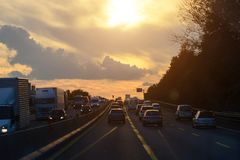 Car traffic jam on the highway during the evening rush hour.Shooting from the car cabin. Toning Stock Photos