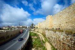 Car traffic on Khativat Yerushalayim Street walls of Old City ne Stock Photos