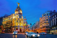 Car and traffic lights on Gran via street Royalty Free Stock Image