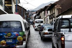 Car Traffic On Narrow Street Cusco Peru South America. Cusco, Peru - June 15, 2015: Cars And Bus On Brick Paved Street Cusco Peru South America With Buildings royalty free stock photo