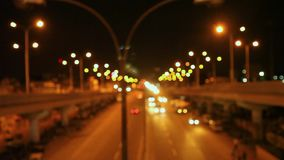 Car traffic night city lights blurred bokeh background. Video of night city road. Cars and bus moving stock video