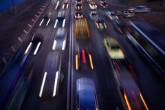 Car traffic at night. Motion blurred background. Royalty Free Stock Photos