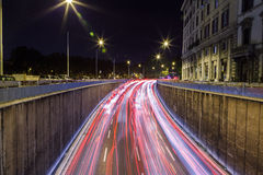 Car traffic at night in Rome Stock Photography