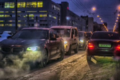 Car traffic at night on the street in winter Stock Photography
