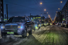 Car traffic at night on the street in winter Stock Photos