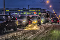 Car traffic at night on the street in winter Royalty Free Stock Photography