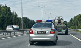 Car traffic police and armored personnel carriers Royalty Free Stock Images