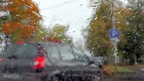 Car traffic in rainy autumn weather stock video footage