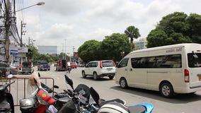 Car and traffic on road in Chiangmai city.