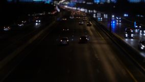 Car on traffic road at night stock footage