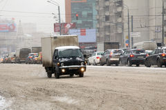 Car traffic during the snowfall in the Moscow Royalty Free Stock Image