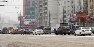 Car traffic during the snowfall in the Moscow Stock Photo