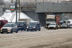 Car traffic during the snowfall in the Moscow Royalty Free Stock Photography
