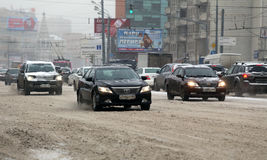 Car traffic during the snowfall in the Moscow Stock Photography