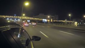 Car traffic on the street at night. Car is moving on the left line in the city on the highway at night stock video footage