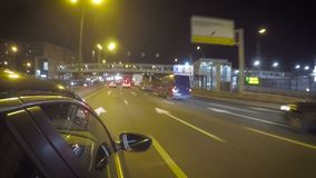 Car traffic on the street at night. Car is moving on the left line on a rough road in the city on the highway at night stock video footage