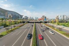 Car traffic on Tianfu avenue in Chengdu. Chengdu, Sichuan Province, China - Sept 21, 2018 : Car traffic on Tianfu avenue with Chengdu south skyline and New royalty free stock image