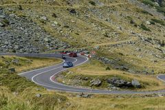 Car traffic on Transfagarasan mountain winding road, from Carpathian mountains in Romania. Stock Photo