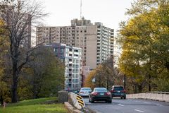 Car traffic on an urban road in Montreal, at fall, on the Cote des Neiges roads, with vehicles passing by. MONTREAL, CANADA - NOVEMBER 4, 2018: ..Picture of cars stock image