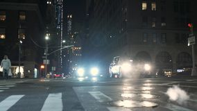Car traffic. Wall Street. New York. ,. Cityscape. cars drive through a pedestrian crossing. Night traffic on the road. Wall Street, New York City stock footage