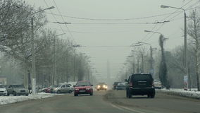Car traffic in winter city. Full HD stock footage